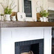 If you're lucky enough to have a kitchen mantle, consider displaying a menu chalkboard.